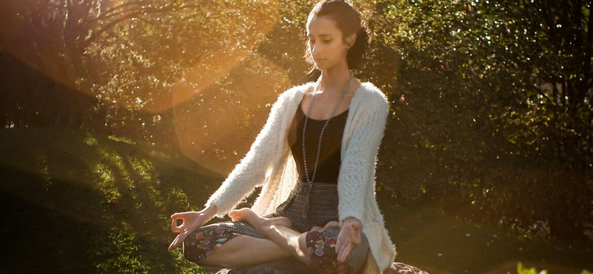 woman-meditating-on-rock-2597205